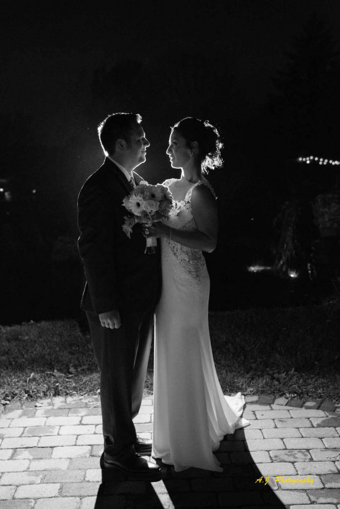 backlit shot of bride and groom together