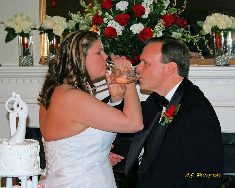 Bride and groom at reception drinking a toast witih champagne