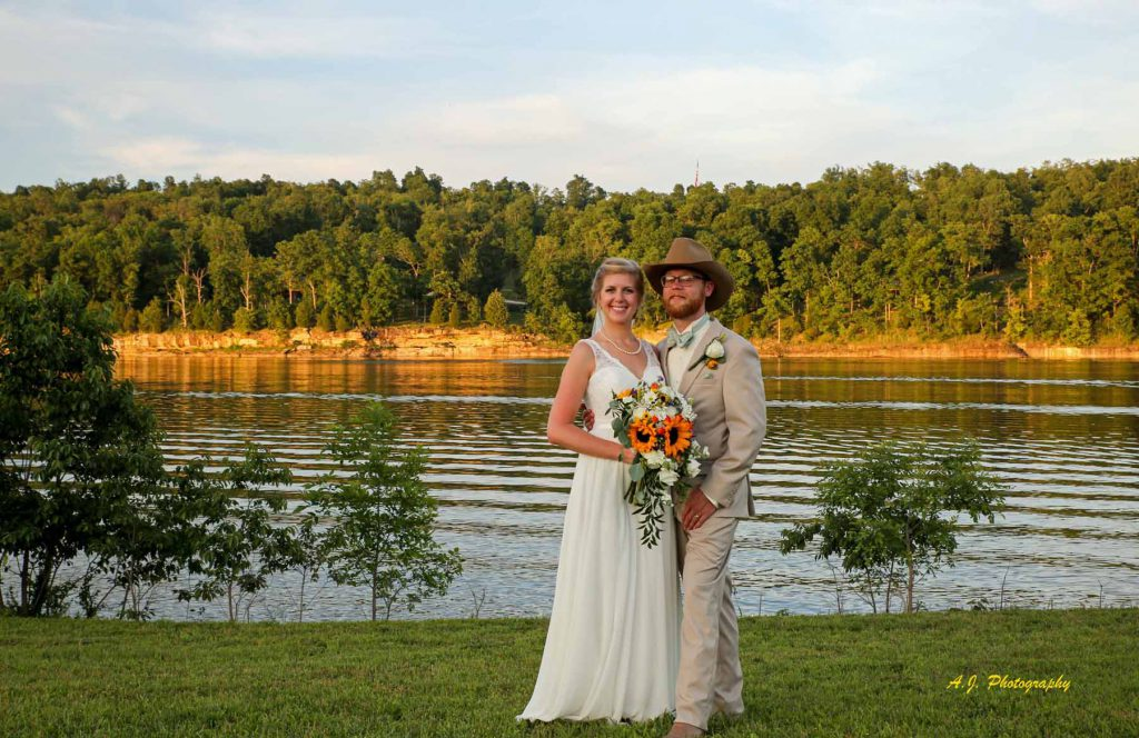 Bride and Groom by the lake at sunset
