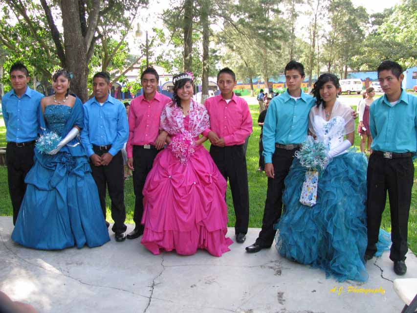 Quinceañera with her court in a park