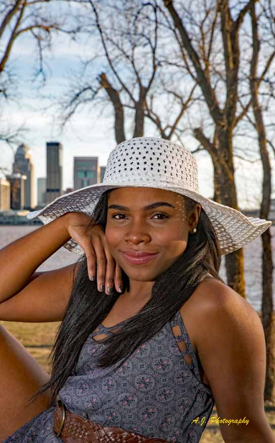 Senior African American girl sitting in a park