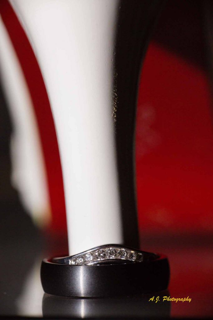 Detail shot of the bride's shoe with wedding rings